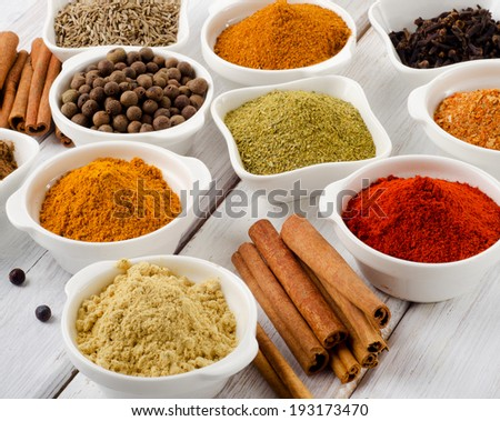 Spices on a wooden table. Selective focus - stock photo