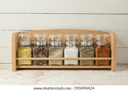Spices on wooden shelf - stock photo