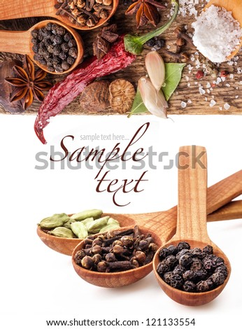 Spices on wooden table with spoons on white background - stock photo