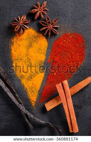 Spices piled on the pattern of broken heart  - stock photo