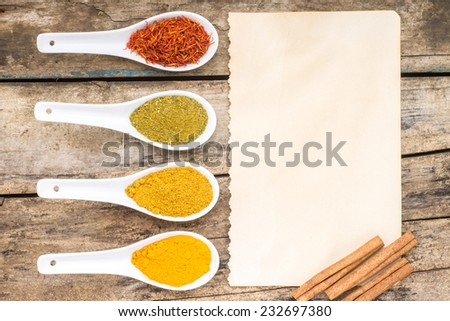 Spices recipe background. Diversity of spicy powder with paper sheet. Top View - stock photo