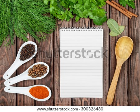 Spices recipe background. Variety of condiments with recipe sheet on old wooden table. Top view - stock photo