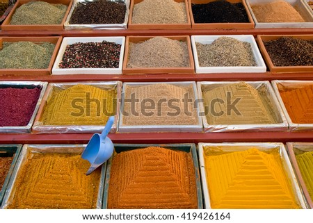 Spices sell. Square small boxes with spices at turkish market - stock photo