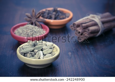Spices set.Various seasonings for cooking, anise, cardamom, cloves in bowls  - stock photo