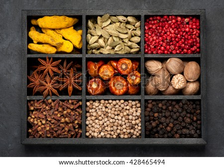 spices, spicy, seasonings  in wooden box. top view, horizontal - stock photo