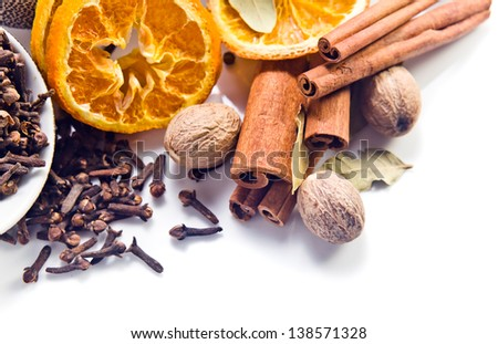 spices with dried oranges on a white background