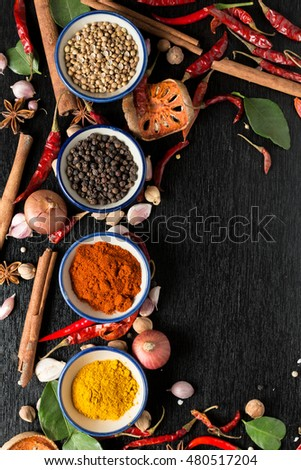 spices with ingredients on dark background. healthy or cooking concept,  asian food