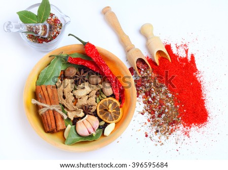 Spices wooden plate spoon spatula Isolated white backround - stock photo