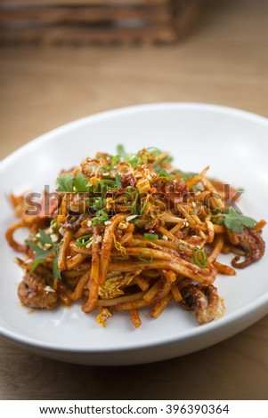 Spicy baby octopus stir fry with udon noodles - stock photo