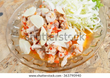 Spicy Boiled Pork with Lime,Garlic and Chili Sauce - stock photo
