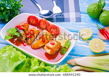 Spicy canned sardine salad and herbs in white plate , Thai food , food design prepare for serving