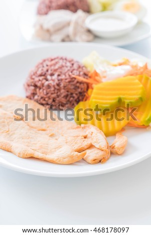 spicy chicken with berry rice - healthy food
