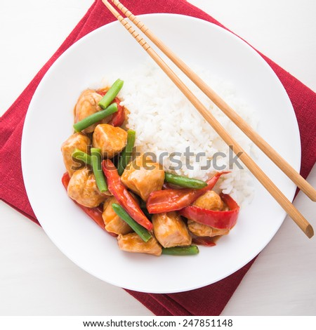 Spicy chicken with vegetables and rice top view. Oriental food. - stock photo
