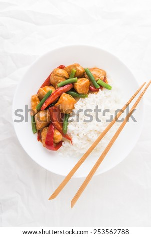 Spicy chicken with vegetables ( green beans and red pepper) and rice on white background top view. Oriental food. - stock photo