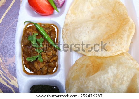 spicy chole bhautre, with green chili topping indian dish