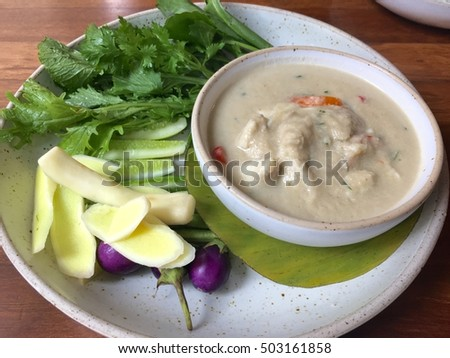 Spicy crabs in coconut soup and vegetables, Thai dish