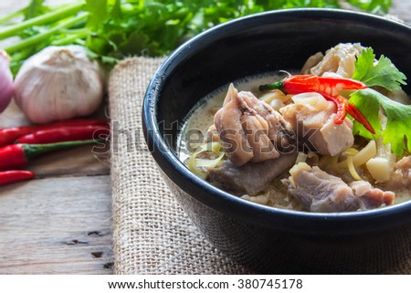 Spicy creamy coconut soup with chicken , Thai food called Tom Kha Gai - stock photo