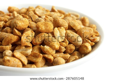 Spicy dry roasted peanuts in white bowl.