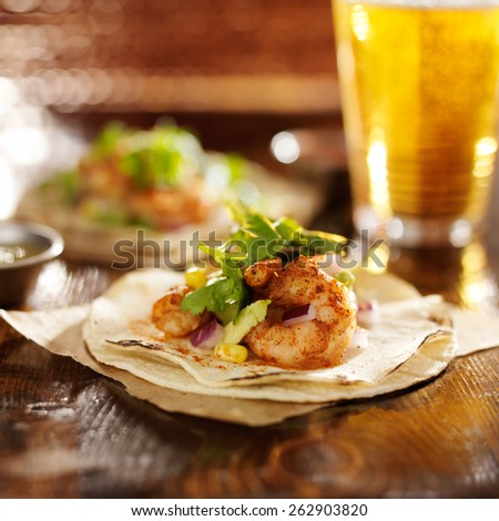 spicy fiesta shrimp tacos with avocado and cilantro - stock photo