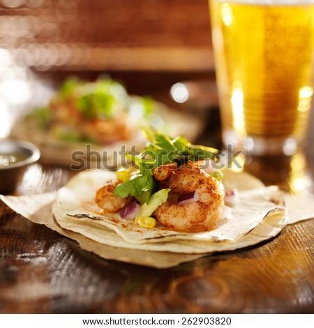 spicy fiesta shrimp tacos with avocado and cilantro - stock photo