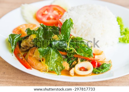 Spicy fried basil leaf with seafood and rice - soft focus point