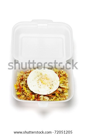 Spicy fried rice with egg in open Styrofoam box on white background