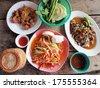 Spicy green papaya salad, spicy duck salad, fried pork (traditional thai food) - stock photo