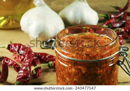 Spicy harissa sauce - a spicy hot Mediterranean diet staple made from cayenne peppers, garlic, olive oil, and spices