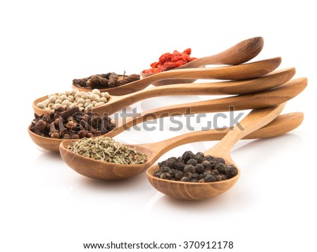 Spicy herb Insert a wooden spoon arranged to prepare food on a white background. - stock photo