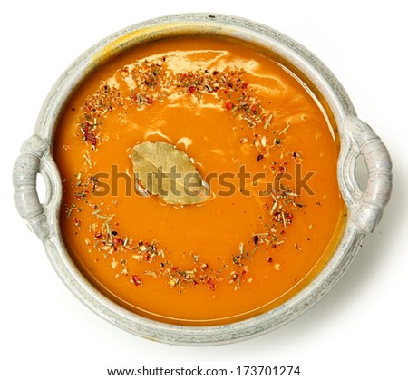 Spicy Hot Butternut Squash Soup in Bowl Top View Over White - stock photo