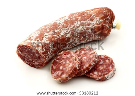 spicy Italian salami sausage and some slices on a white background - stock photo