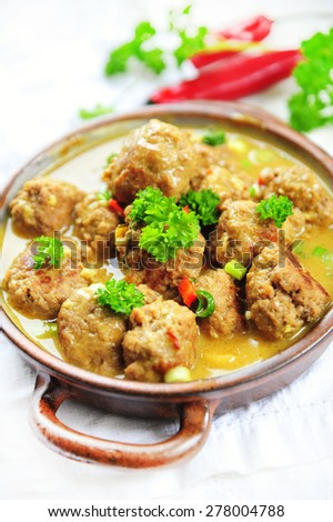 Spicy meatballs  in a curry sauce