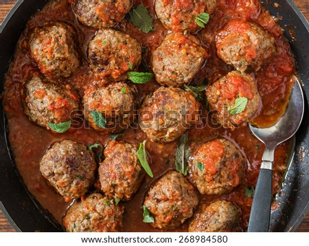 Spicy Meatballs with Couscous. Shallow Depth of Field. - stock photo