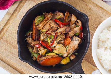 Spicy Mexican pork stirfry in a cast iron skillet - stock photo