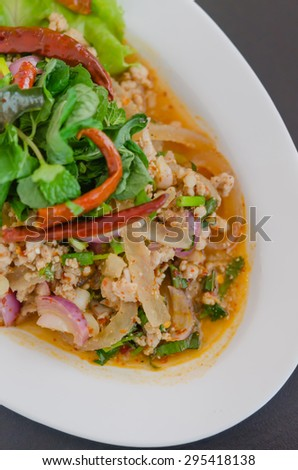 spicy minced pork eaten with fresh vegetable on plate , asian food