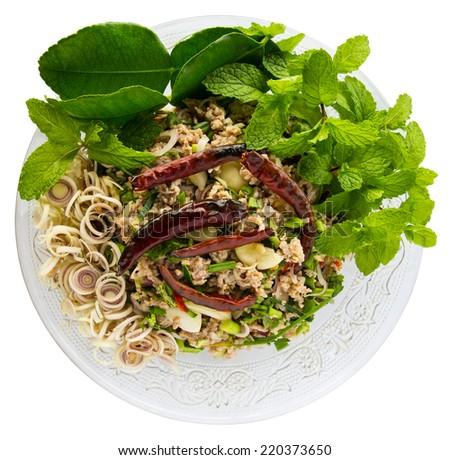 Spicy minced pork salad with kaffir lime leaves, mint, lemongrass, dried chili. - stock photo