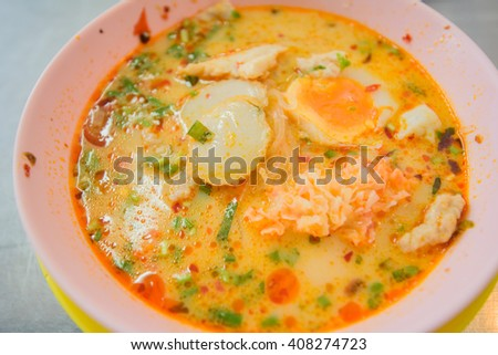 spicy noodle fish with boiled eggs