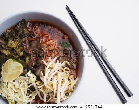 Spicy noodle soup, northern of Thailand style cuisine (Nam Ngiao)