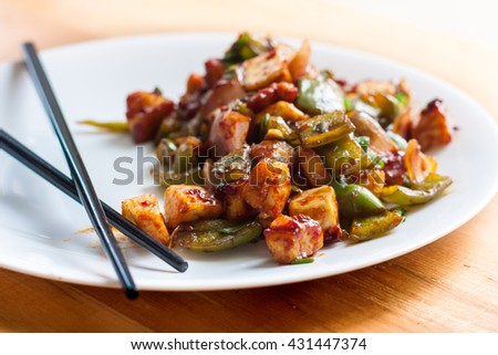 Spicy Paneer(cottage cheese) Dish with chopsticks