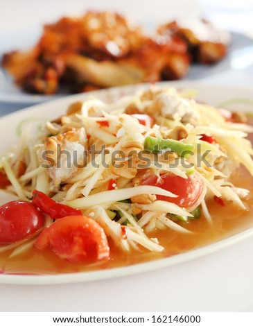 spicy papaya salad and roasting chicken (Thai style food)
