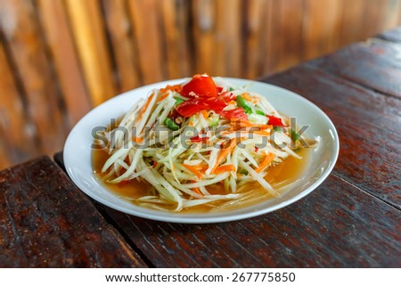 Spicy papaya salad (Somtum) - stock photo