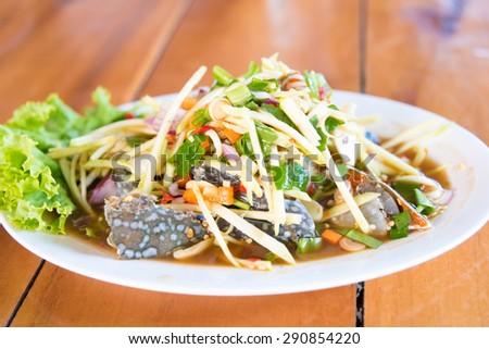 spicy papaya salad with blue crab, som tum poo ma,Som Tum, Thai papaya salad. Traditional Thai food - stock photo