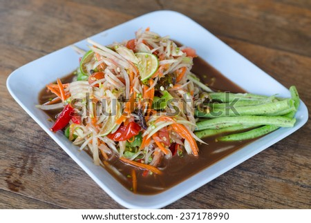 spicy papaya salad with salted crab and fermented fish - stock photo