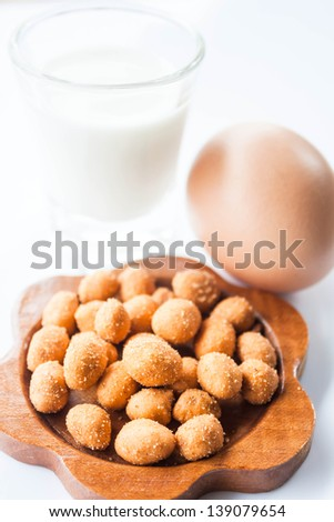 Spicy peanut, low fat milk and egg - stock photo