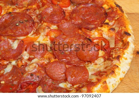 Spicy pizza with salami sausages and chilli peppers