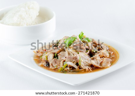 spicy pork salad and sticky rice for thai food - stock photo