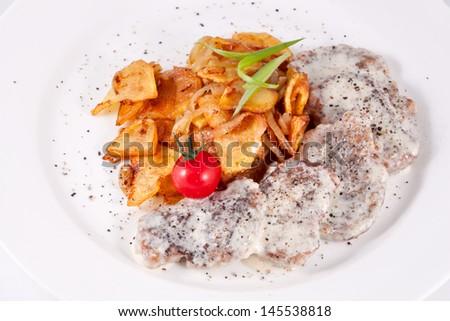 Spicy pork with baked potato - stock photo