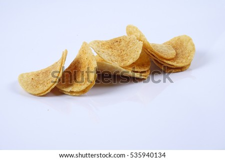 Spicy potato chips on white background.