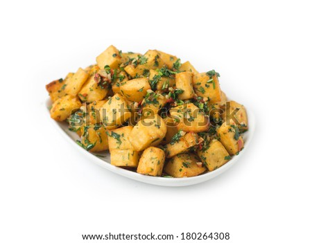 Spicy potato cut in cubes and fried, lebanese cuisine  - stock photo
