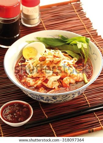 Spicy prawn noodle soup - stock photo